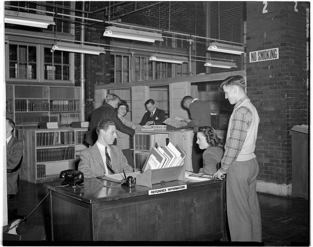 picture of students at reference desk 1947, University of Illinois Navy Pier Campus