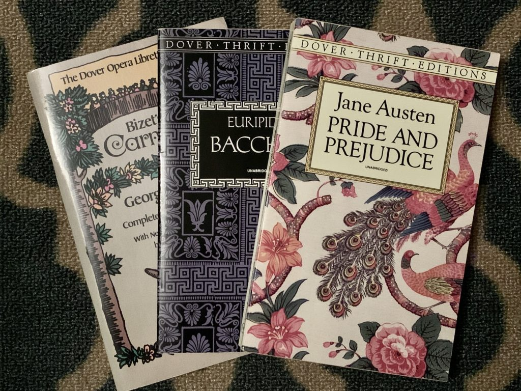 Dover editions of Bizet's Carmen, Euripides's Bacchae, and Austen's Pride and Prejudice.