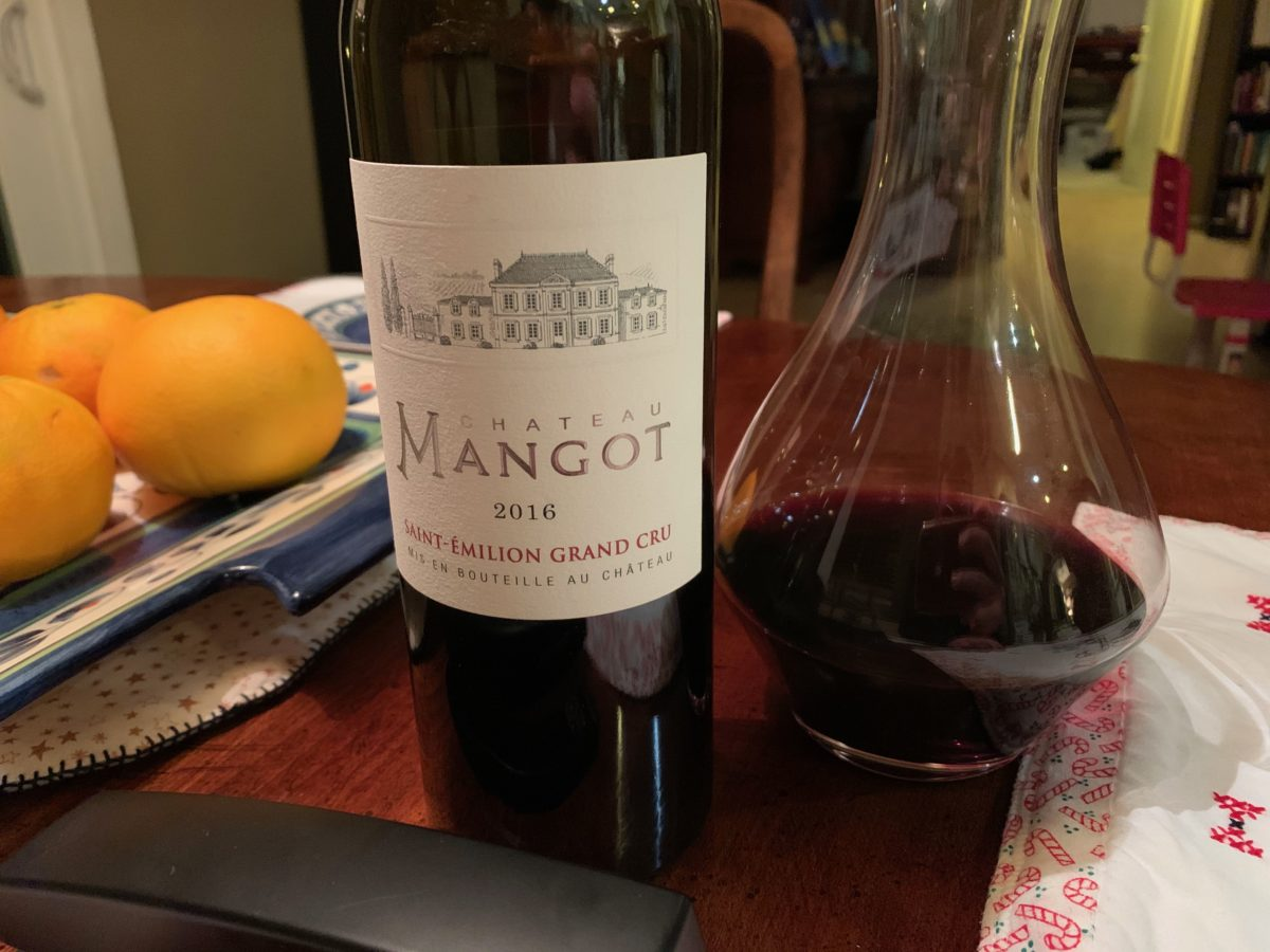 bottle of chateau mangot wine with carafe